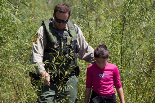 Border Patrol rescues immigrant girl stranded on banks of Rio Grande. US Customs and Border Protection on Flickr, Some rights reserved
