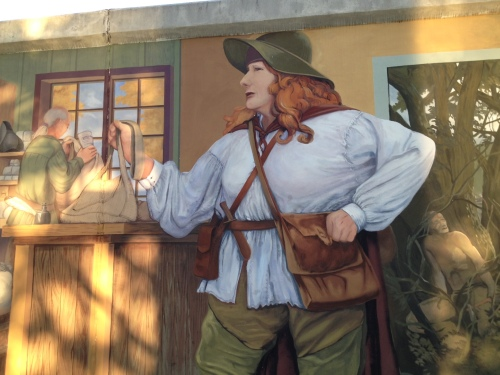 Anne Bailey in one of the dozens of mural panels along the river walk.