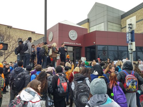 In the morning, South High School students held a sit in for four and half hours (the length of time Michael Brown's body was on the street after he was killed). Then they walked out and marched to the Minneapolis police 3rd precinct. Police cars blocked traffic for the march. 2014-11-25 This photo and text is licensed under a Creative Commons Attribution License by Fibonacci Blue