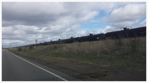 Photo of BNSF oil train by Joshua Putnam, published under Creative Commons license.