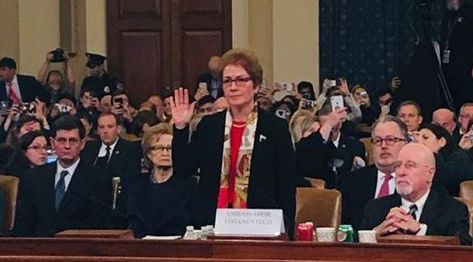 Marie Yovanovitch taking her oath before testifying to the House impeachment committee.
